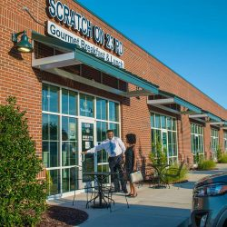 Two people enter Scratch on 23rd, in the flex building at the ILM Business Park