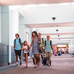 A family walks down towards their plane